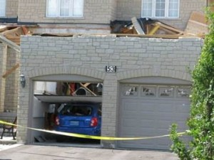 The garage roof from this relatively newer home in Woodbridge or Maple, Ontario was lost in one of two F2 tornadoes that tore through Vaughan on August 20, 2009. Where did the roof go? It stuck the neighbour's home, doing extensive damage.
