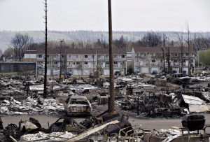 The devastated neighbourhood of Abasand is shown in Fort McMurray, Alta., on Friday, May 13, 2016. A wildfire left a swath of destruction last week. THE CANADIAN PRESS/Jason Franson